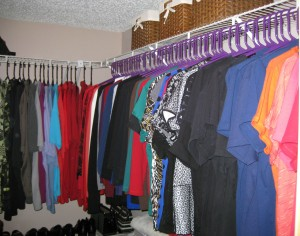 Bins on top of the closet to keep belts and other small acessories organized