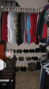 Lower racks added to a closet to store shoes.