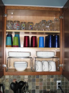 Organized kitchen cabinet with small racks.
